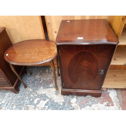 619 - TWO ITEMS TO INCLUDE A FLAME MAHOGANY MUSIC CABINET AND A MAHOGANY EFFECT OVAL SIDE TABLE...