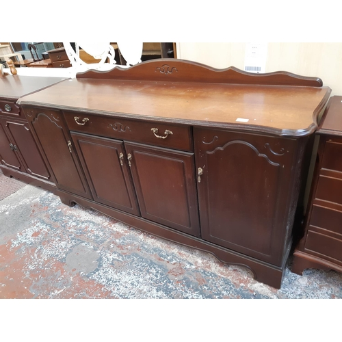 621 - A ROSSMORE MAHOGANY EFFECT SIDEBOARD WITH FOUR DOORS AND ONE DRAWER...