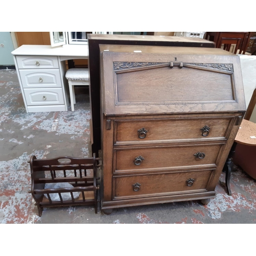 628 - A VINTAGE OAK BUREAU WITH THREE DRAWERS AND FALL FRONT...