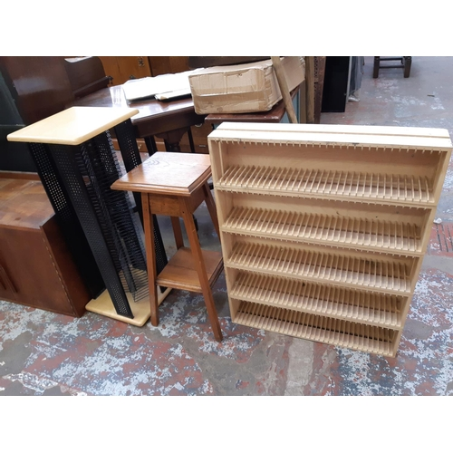 629 - THREE ITEMS TO INCLUDE A MODERN WOODEN CD RACK, AN ARTS AND CRAFTS OAK PLANT STAND AND A BEECH AND M...