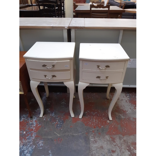 638 - A PAIR OF FRENCH STYLE CREAM PAINTED BEDSIDE TABLES WITH TWO DRAWERS...
