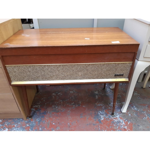 639 - A RETRO CAROUSEL DANSETTE TEAK RECORD PLAYER CABINET AND CONTENTS...