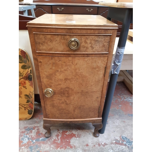 645 - AN ANTIQUE STYLE BURR WALNUT BEDSIDE CABINET WITH ONE LOWER CUPBOARD DOOR AND ONE DRAWER ON CABRIOLE...