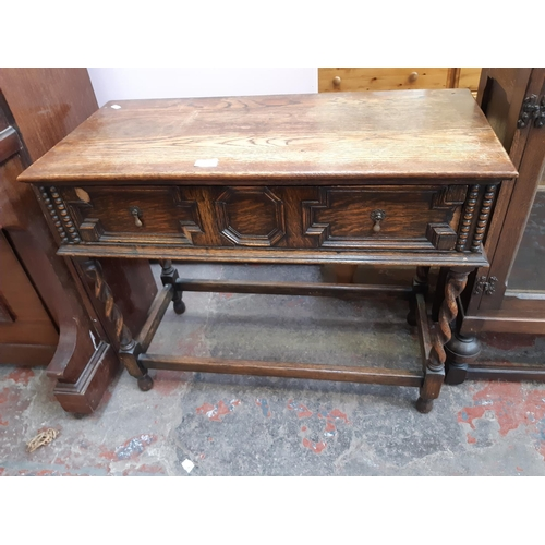 649 - A VINTAGE OAK HALL TABLE WITH ONE DRAWER, CARVED DECORATION AND BARLEY TWIST SUPPORTS...