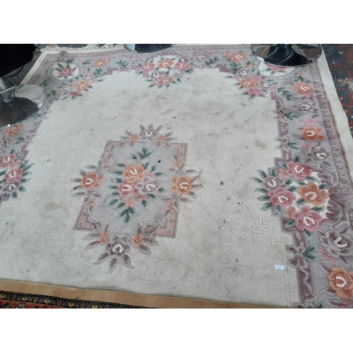675 - A LARGE CREAM FARMHOUSE RUG WITH FLORAL DECORATION...