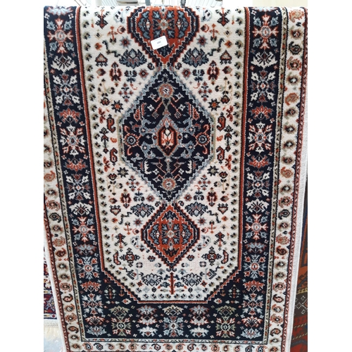 680 - AN ANTIQUE STYLE TASSELLED RUG...