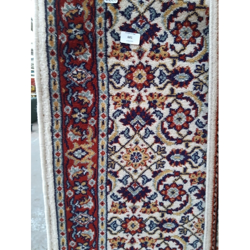 681 - AN ANTIQUE STYLE TASSELLED RUG...