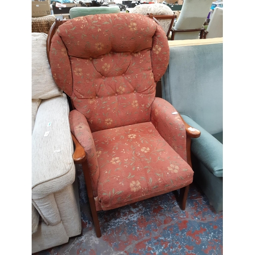 692 - A CHERRYWOOD FRAMED JOYNSON HOLLAND ARMCHAIR WITH FLORAL UPHOLSTERED SEAT AND BACK...