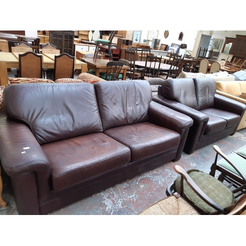 700 - A GOOD QUALITY KLAUSSNER FURNITURE BROWN LEATHER UPHOLSTERED THREE SEAT SOFA TOGETHER WITH A MATCHIN...