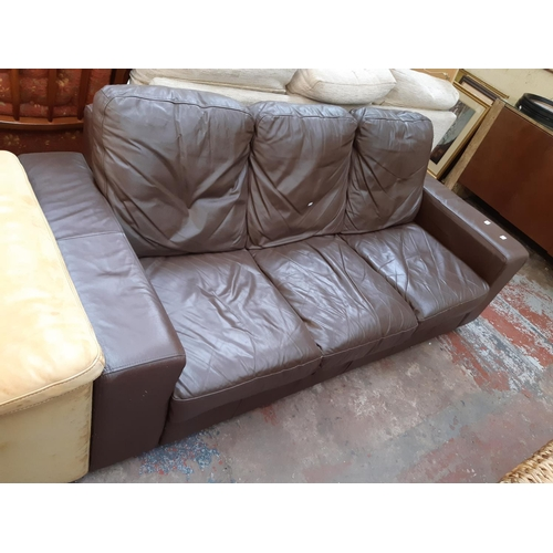 703 - A MODERN BROWN LEATHERETTE THREE SEAT SOFA...