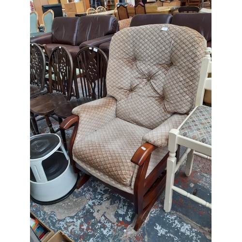 712 - A MAHOGANY FRAMED ROCKING ARMCHAIR WITH BROWN UPHOLSTERY TOGETHER WITH A KIKALONG WAREHOUSE STEP...