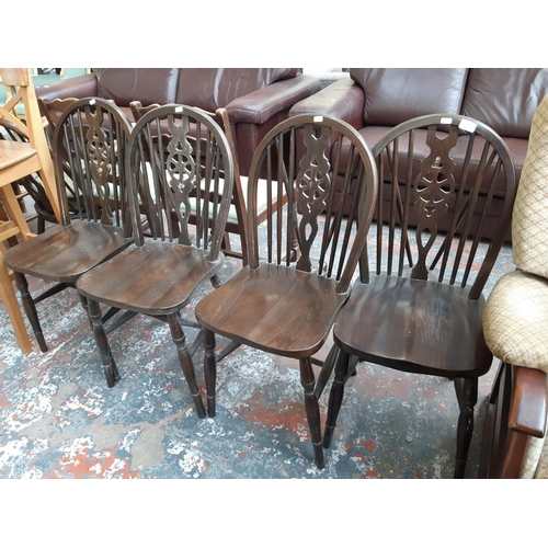 713 - A SET OF FOUR VINTAGE ELM WHEEL BACK DINING CHAIRS...