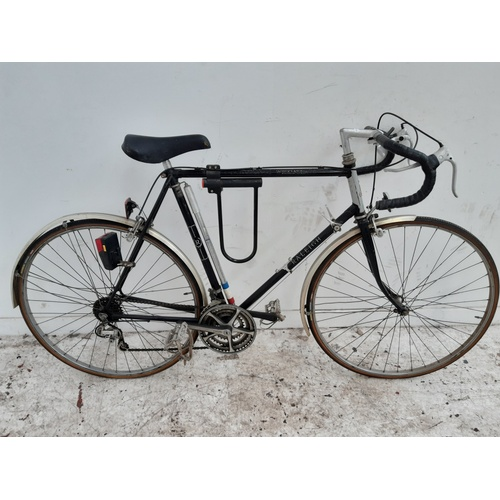 5 - A BLACK RALEIGH WEEKENDER MENS RACING BIKE WITH 15 SPEED SUNTOUR GEAR SYSTEM...