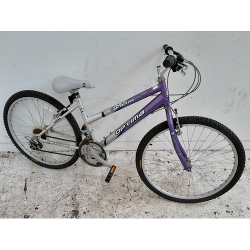 7 - A PURPLE AND GREY OPTIMA STORM GIRLS MOUNTAIN BIKE WITH 18 SPEED SHIMANO GEAR SYSTEM...