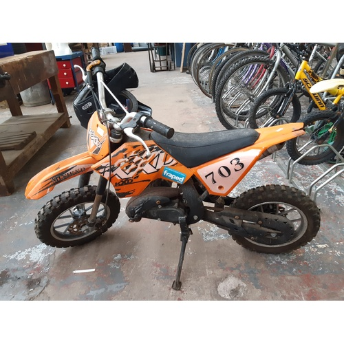 11 - TWO ITEMS TO INCLUDE AN ORANGE TWO STROKE MOTOR CROSS BIKE WITH TWIN DISC BRAKES AND A BLACK ZINC CR...