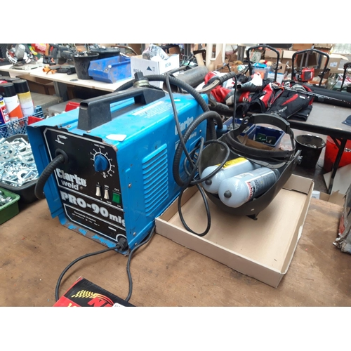 101 - A BLUE CLARKE PRO 90 MIG WELDER TOGETHER WITH TWO BOTTLES OF GAS, AN AS NEW ROLL OF ALUMINIUM WIRE A...
