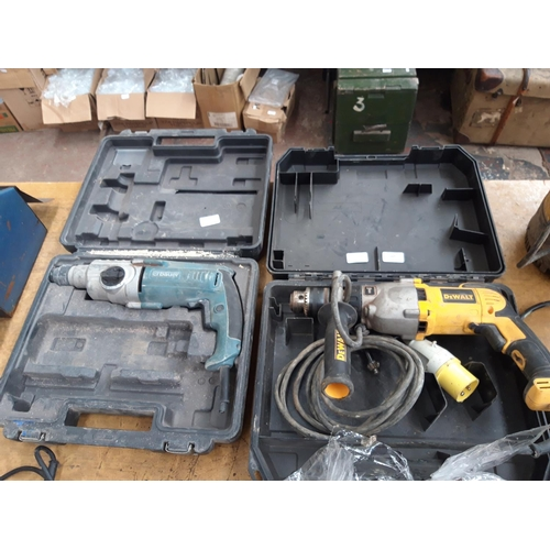 117 - TWO CASED ELECTRIC DRILLS - ONE YELLOW DEWALT D21570 110V AND ONE BLUE ERBAUER MAINS ELECTRIC (REQUI...