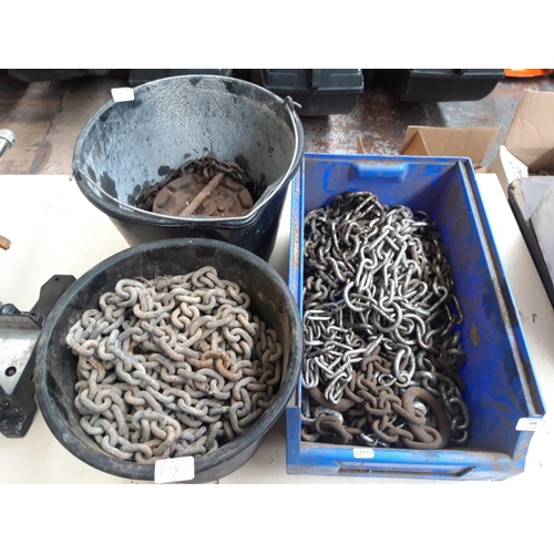 154 - A BOX AND TWO BUCKETS CONTAINING A LARGE QUANTITY OF CHAIN AND A CHAIN BLOCK AND TACKLE...