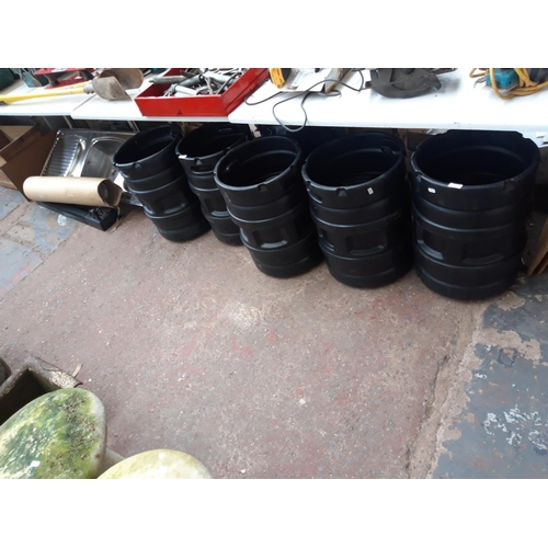 174 - A MIXED LOT OF NINE ITEMS TO INCLUDE BLACK PLASTIC BARRELS, STAINLESS STEEL DOUBLE SINK AND DRAINER,...
