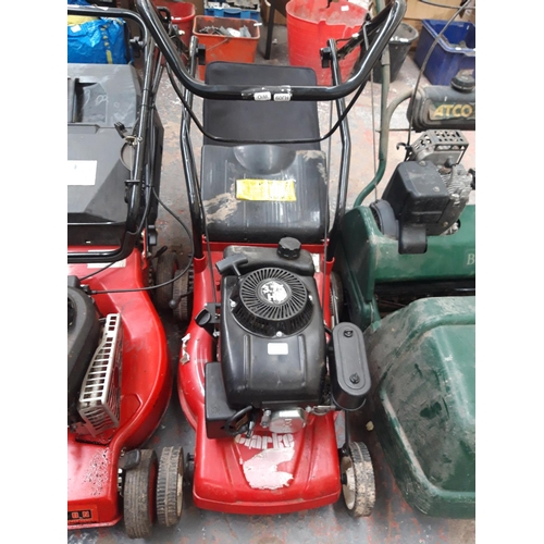 185 - A BLACK AND RED CLARKE PETROL LAWN MOWER WITH GRASS COLLECTOR (W/O)...