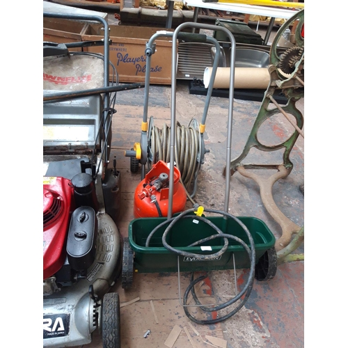 194 - TREE ITEMS TO INCLUDE A HOSELOCK HOSE REEL, A MANUAL EVERGREEN SEED SPREADER AND A 3.9 KG PROPANE GA...