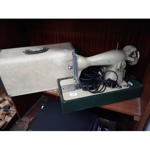 210 - A CASED VINTAGE GREEN AND CREAM BROTHER DELUXE ELECTRIC SEWING MACHINE WITH FOOT PEDAL...