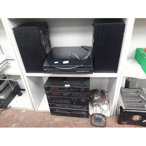 233 - AN IOWA STEREO SYSTEM COMPRISING OF TWIN TAPE, TUNER AMP, TURNTABLE AND TWO MATCHING SPEAKERS...
