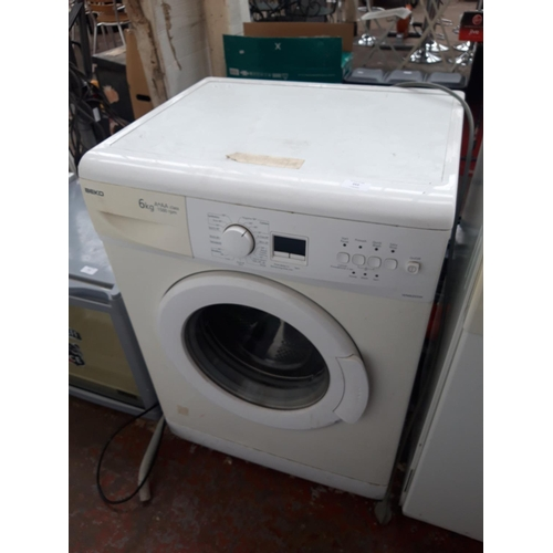 252 - A BEKO WM6355W 6 KILO WASHING MACHINE (W/O)...