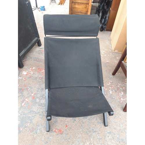 27 - A BLACK FOLDING CHAIR...