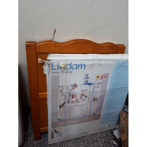 29 - TWO ITEMS TO INCLUDE A CHILDS PINE COT WITH MATTRESS AND A BOXED LINDAN STAIR GATE...