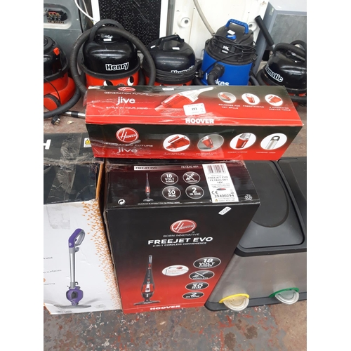 293 - TWO BOXED HOOVER VACUUM CLEANERS - ONE HAND HELD AND ONE TWO IN ONE CORDLESS...
