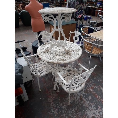 33 - SIX ITEMS TO INCLUDE A WHITE PAINTED CAST ALUMINIUM PEDESTAL TABLE AND A FIVE PIECE WHITE PAINTED CA...