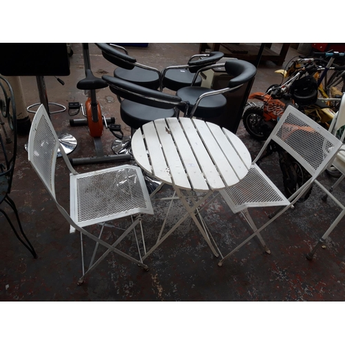36 - THREE ITEMS TO INCLUDE A FOLDING WOOD AND METAL PATIO TABLE AND TWO MESHED METAL CHAIRS...