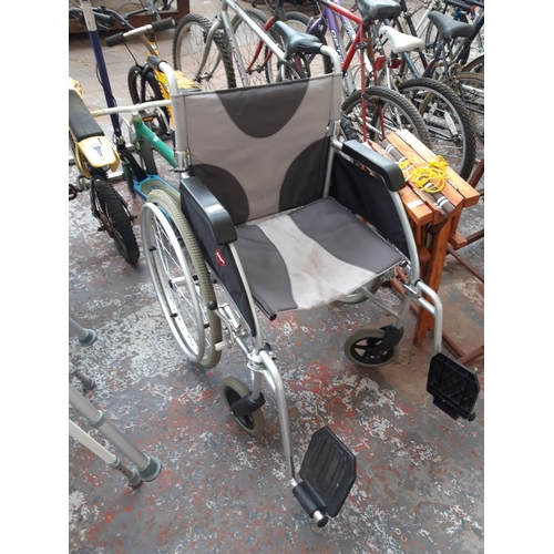 38 - A BLACK AND GREY ENIGMA SELF PROPELLED WHEELCHAIR...