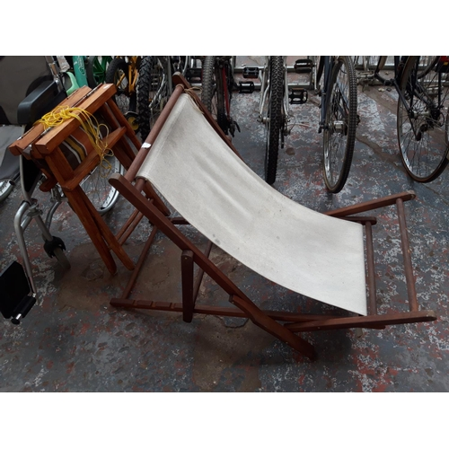 39 - TWO ITEMS TO INCLUDE A TRADITIONAL WOODEN DECKCHAIR AND A FOLDING WOODEN DIRECTORS CHAIR WITH STRIPE...