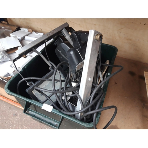 53 - A BOX CONTAINING HALOGEN SECURITY LIGHTS, ELECTRICAL CABLE ETC....
