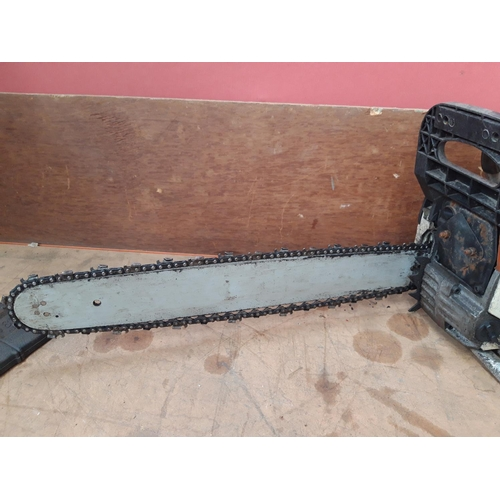 57 - AN ORANGE AND WHITE NEILSEN CT3795 PETROL CHAINSAW WITH 18