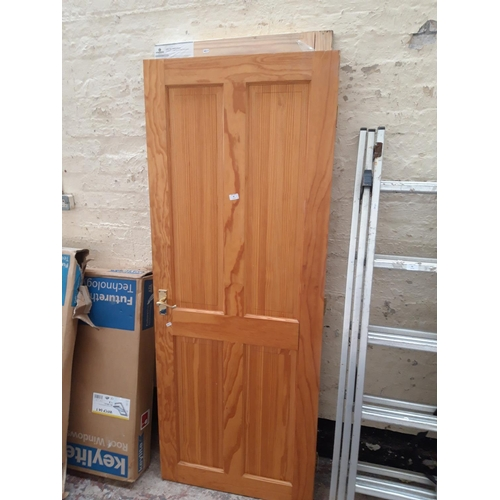 92 - TWO PINE INTERIOR DOORS - ONE MEASURING APPROX. 77