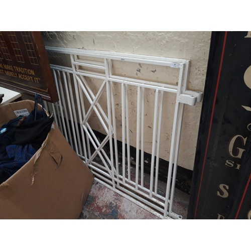 96 - TWO WHITE PAINTED METAL GARDEN GATES - MEASURING APPROX. 46 X 39