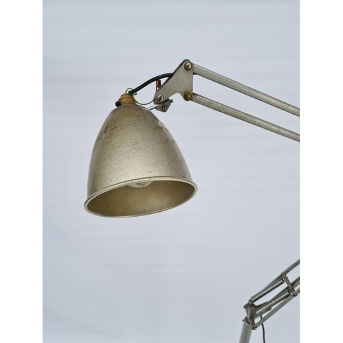 7 - A 1960'S HERBERT TERRY 1209 ANGLEPOISE FLOOR LAMP ON CASTORS - MEASURING APPROX. HEIGHT FULLY EXTEND...
