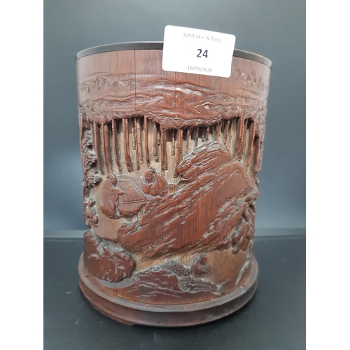 A 19th century chinese hand carved 3 dimensional bamboo shoot brush pot with garden, mountain and figure design - measuring approx. 16.5cm in height