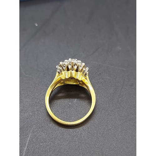 84 - An excellent quality ladies hallmarked 18ct yellow gold, 1.38ct diamond cluster ring with nine inset...