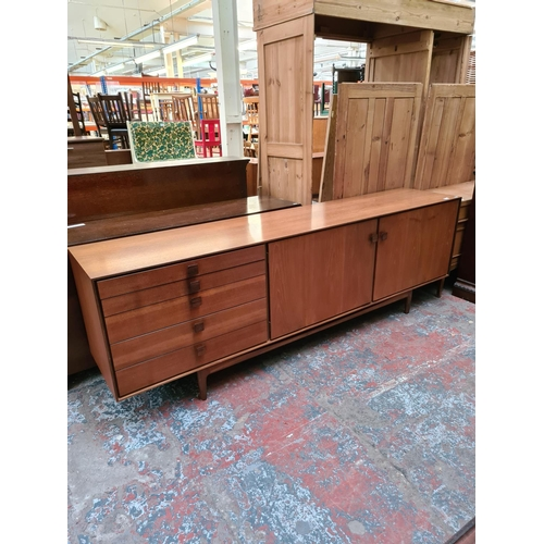 561 - A 1960s G Plan Danish range teak sideboard with rosewood handles and afromosia supports designed by ...