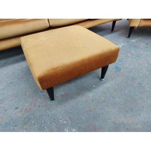 676 - A mid 20th century G Plan mustard upholstered four piece lounge suite comprising four seater sofa, t...