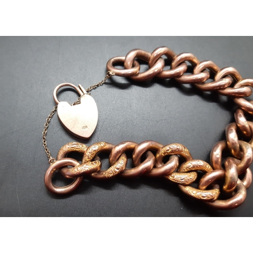 10 - A 9ct gold chain link bracelet with 9ct gold heart shaped charm - approx total weight. 28.66 grams t...