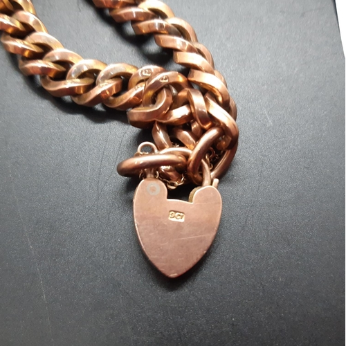 11 - A 9ct gold chain link bracelet with 9ct gold heart shaped charm - approx total weight. 13.97 grams...