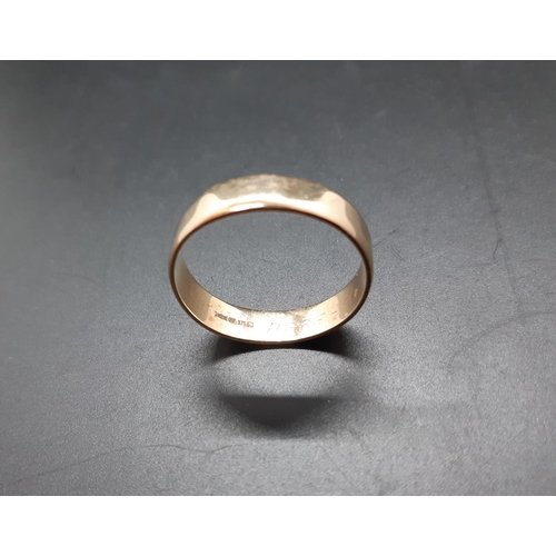 15 - A hallmarked 9ct gold wedding band - approx total weight. 5.15 grams and size Z + 3...