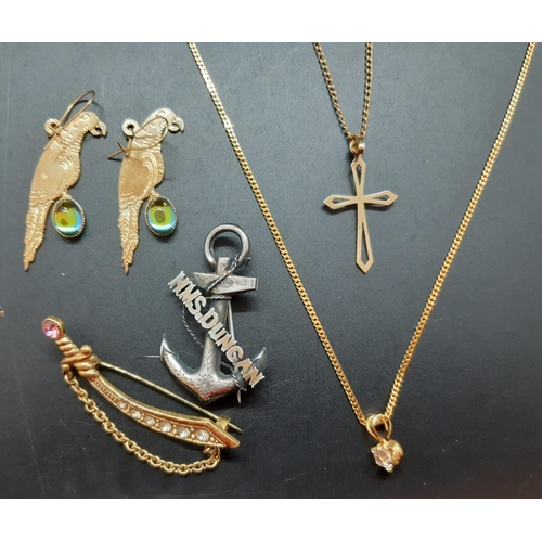 18 - Seven items to include a stamped 9ct gold cross pendant necklace approx. 2 grams, hallmarked Birming...