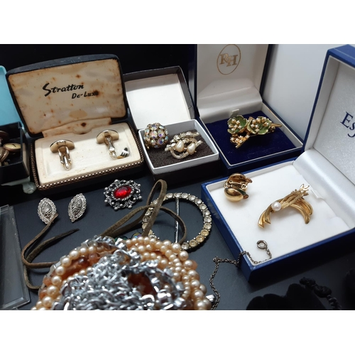 21 - A large quantity of various costume jewellery...