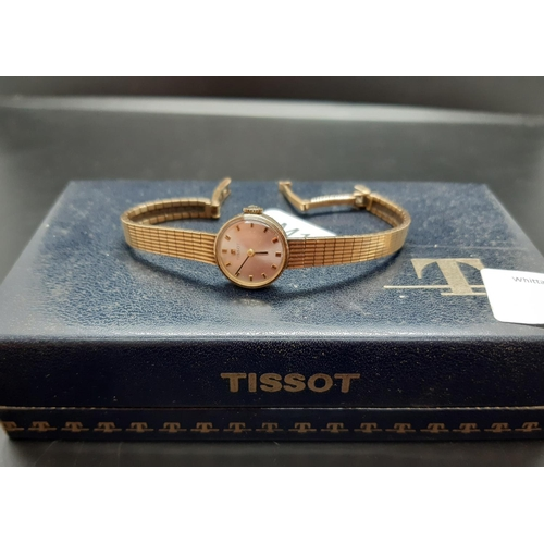 22 - A cased Tissot hallmarked 9ct gold ladies wristwatch - approx. total weight with movement 17.1 grams...